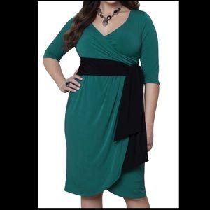 Super sexy, curve skimming faux wrap dress